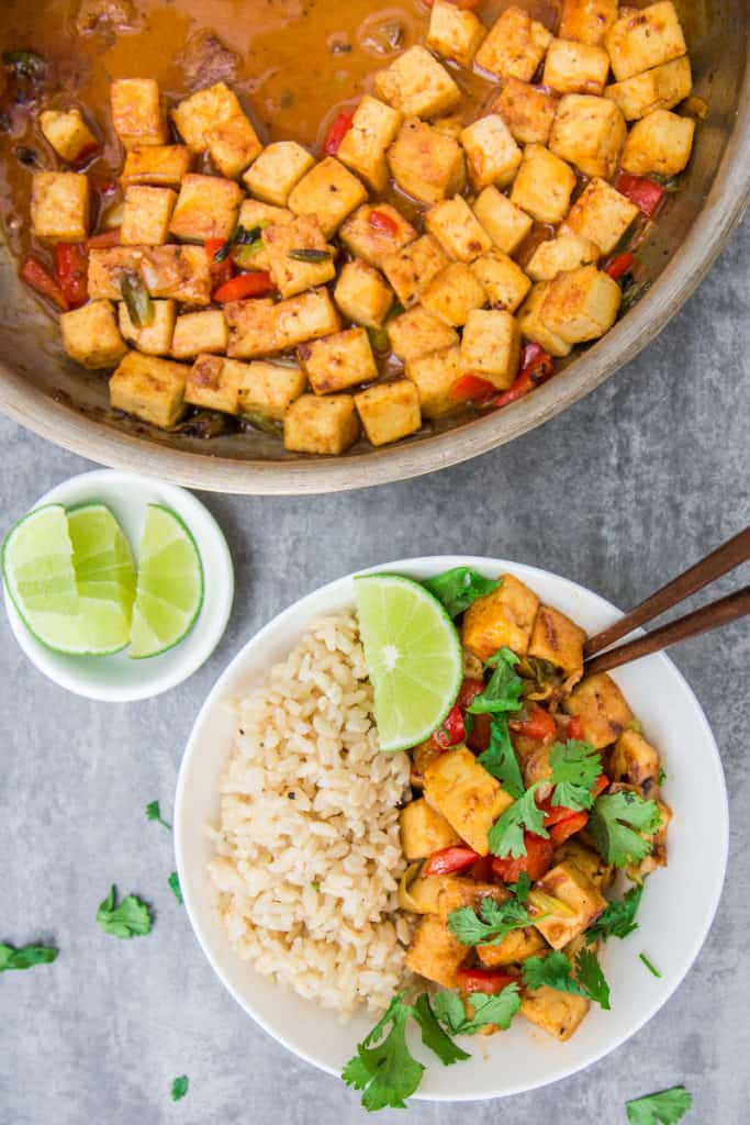 easy thai curry tofu made with coconut milk in pan and bowl ready to be served