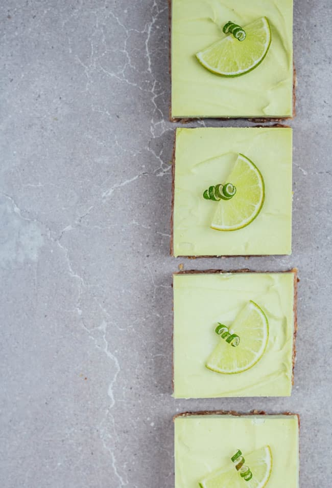 4 key lime pie bars on a grey board