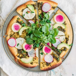 Chickpea crust pizza with walnut pesto