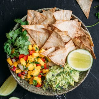 Baked corn chips with guacamole and mango salsa
