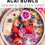vegan blueberry acai bowls made with almond milk and fruit and seeds on top