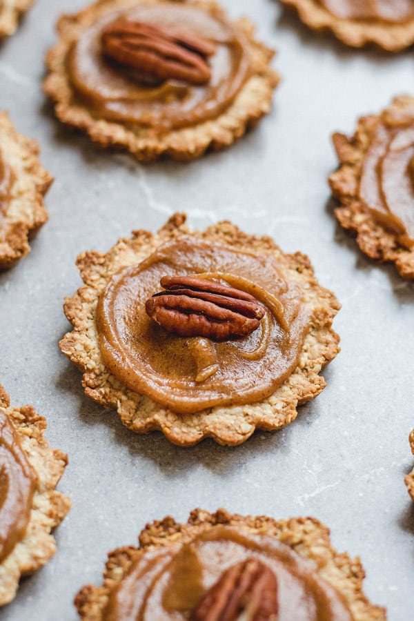 These healthy mini pecan pies are the perfect vegan and gluten-free holiday treat!