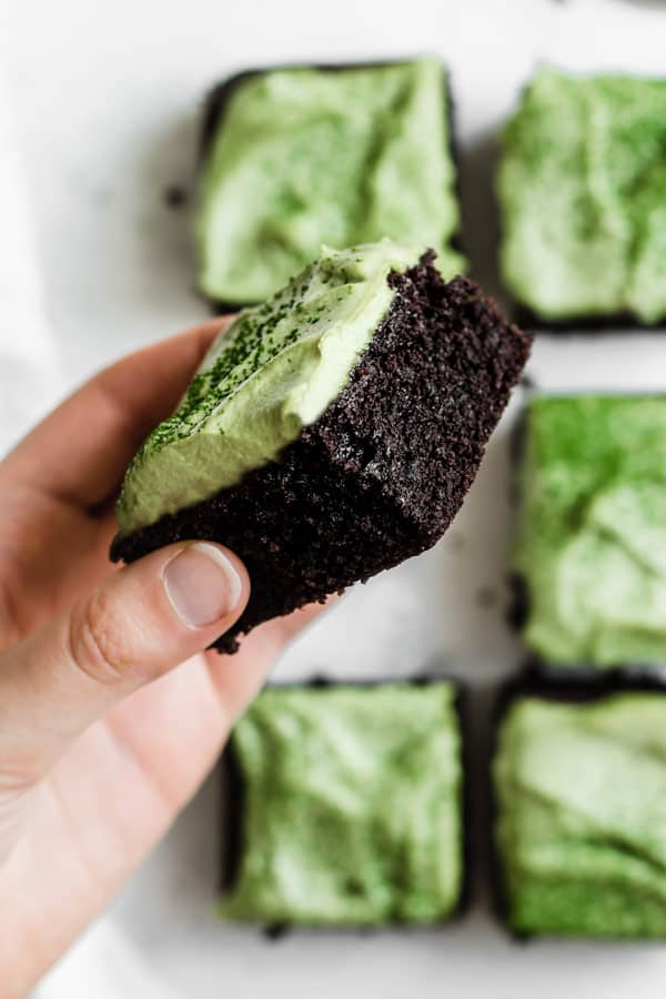 gluten free almond flour brownies with matcha frosting being held