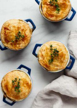 veggie pot pies in blue casserole dishes
