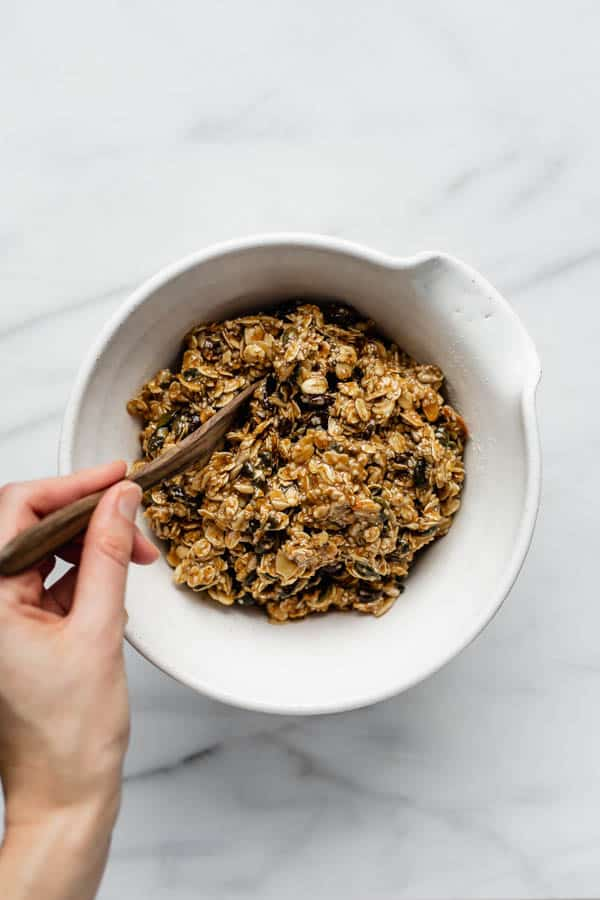 healthy breakfast cookie dough in a white mixing bowl with a wooden spoon