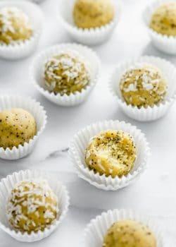 Lemon poppy seed bliss balls on a marble board