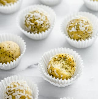 Lemon poppy seed bliss balls on a marble board