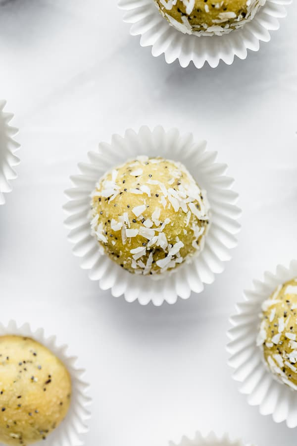 lemon poppyseed energy bites on a marble board