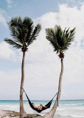 lounging in a hammock on the beach in Tulum mexico