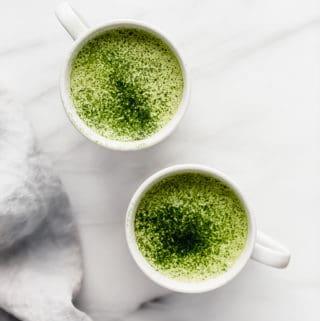 two cups of matcha tea latte