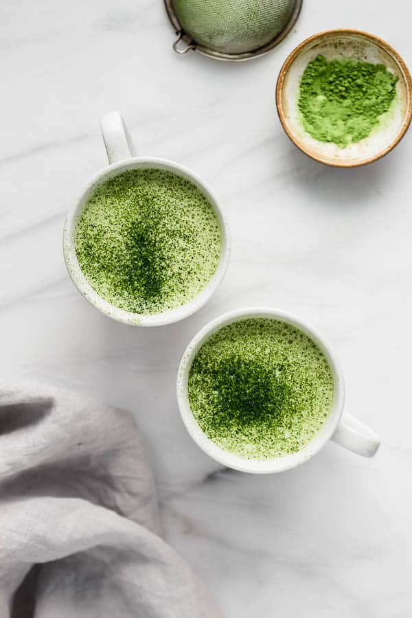 mugs filled with a matcha tea latte