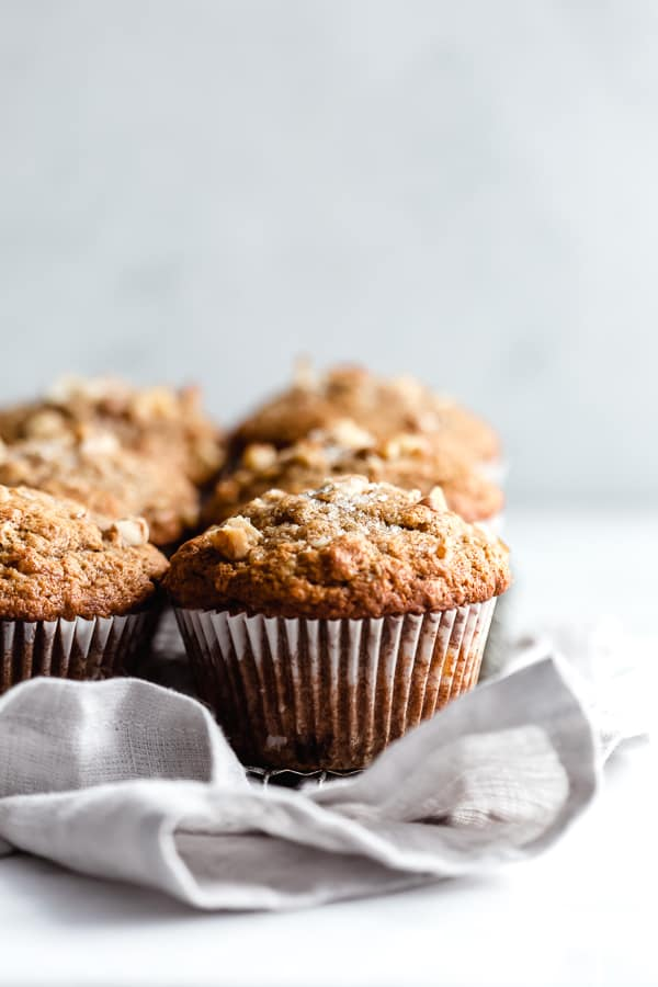 close up of banana nut muffin on a linen napkin