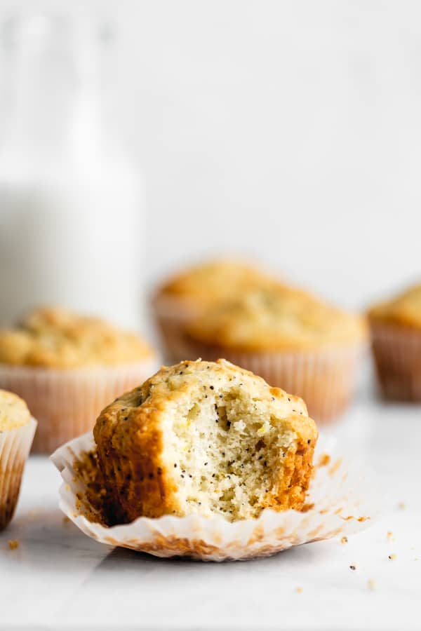 a healthy lemon poppyseed muffin with a bite in it
