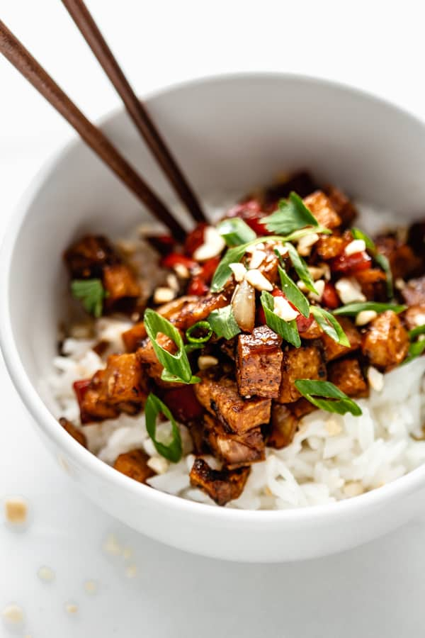 Kung pao tofu in a bowl with chopsticks