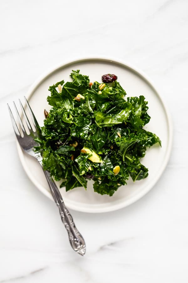massaged kale salad recipe on a plate