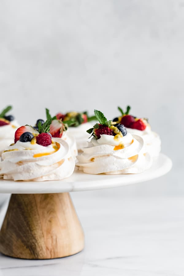 mini pavlovas with coconut whipped cream