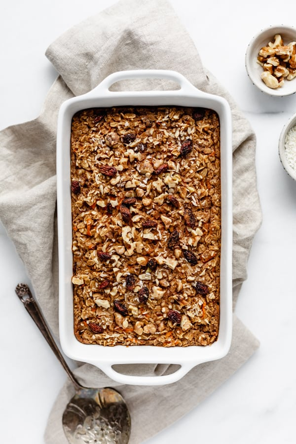 carrot cake baked oatmeal in a baking dish on a napkin