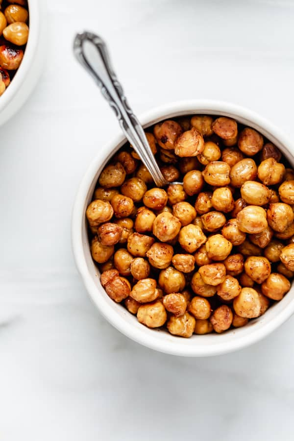 roasted chickpeas in a bowl with a spoon