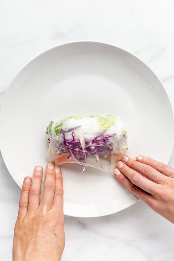 showing how to fold a fresh spring roll