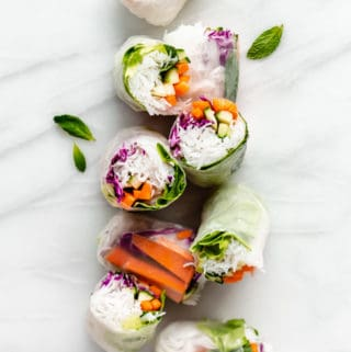 cut up rice paper rolls on a marble board
