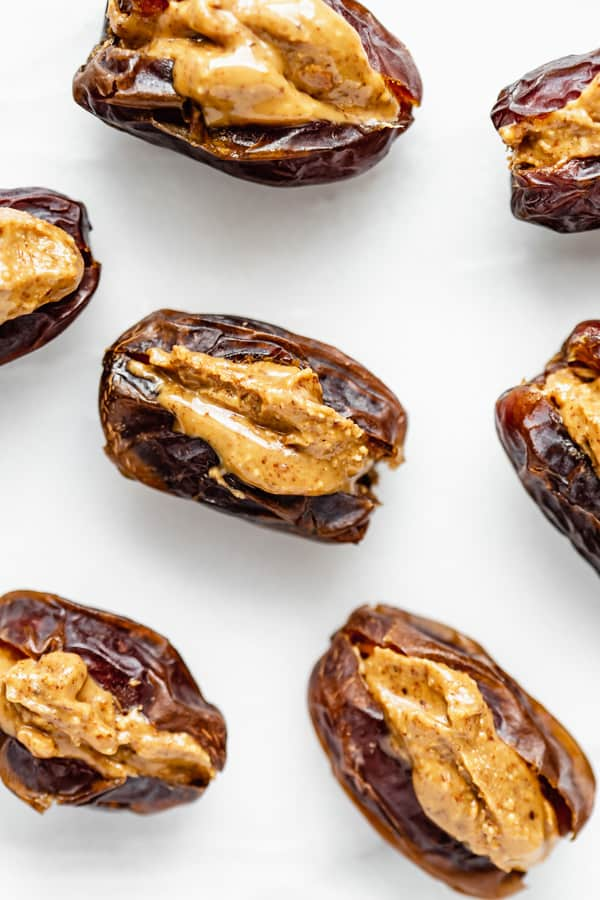 dates with almond butter in the centre