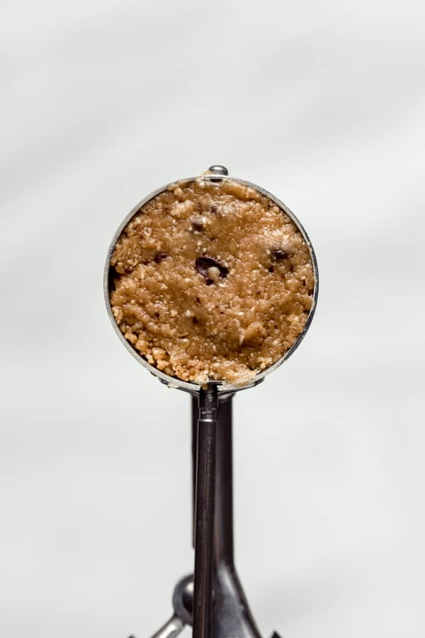 peanut butter oatmeal cookie dough in a cookie scoop