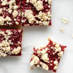 raspberry crumble bar with a bite taken out of it