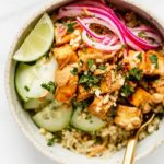 a bowl with tofu pickled onions and cucumber on quinoa