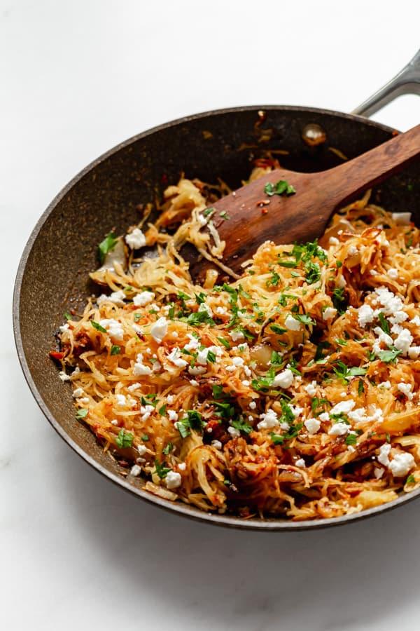 a pan with sun-dried tomato pesto spaghetti squash