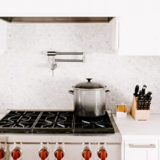 a kitche stove with a pot on it