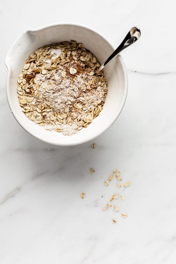 a bowl of oats flour and coconut sugar