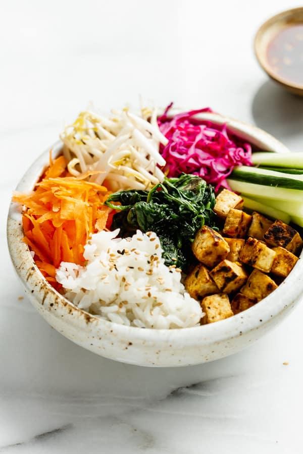 vegan bibimbap in a white ceramic bowl