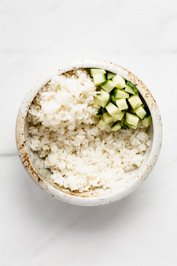a bowl of rice with cucumber