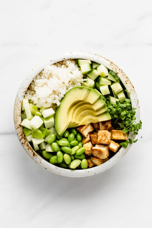 poke bowl with tofu avocado and green vegetables
