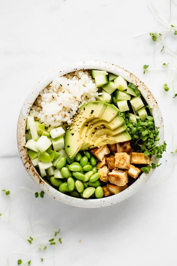 tofu rice and vegetables in a while ceramic bowl