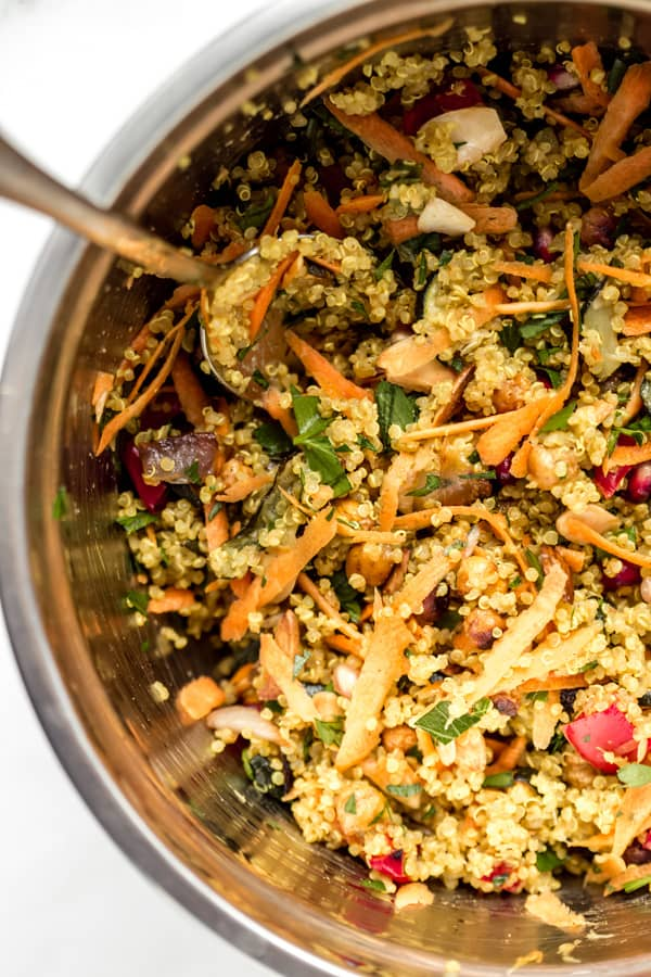 a close-up photo of Moroccan quinoa salad in a large metal bowl