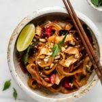 drunken noodles in a white ceramic bowl