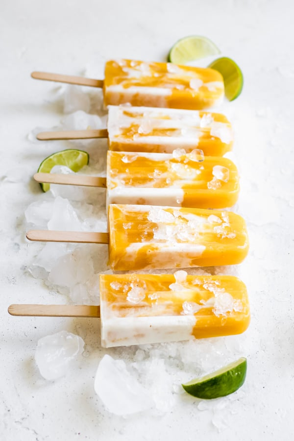 5 mango lassi popsicles on ice