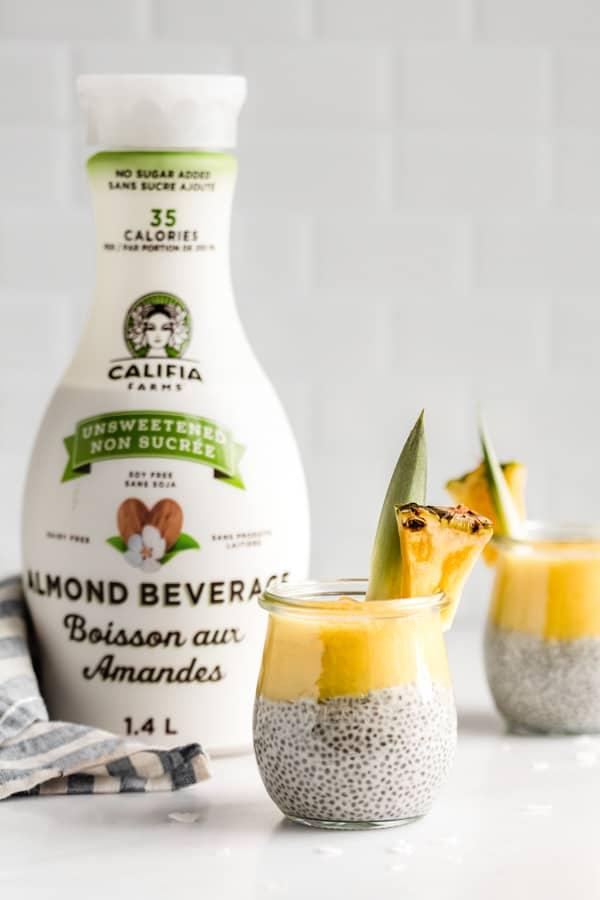 a jar of chia pudding and a bottle of califia farms almond milk