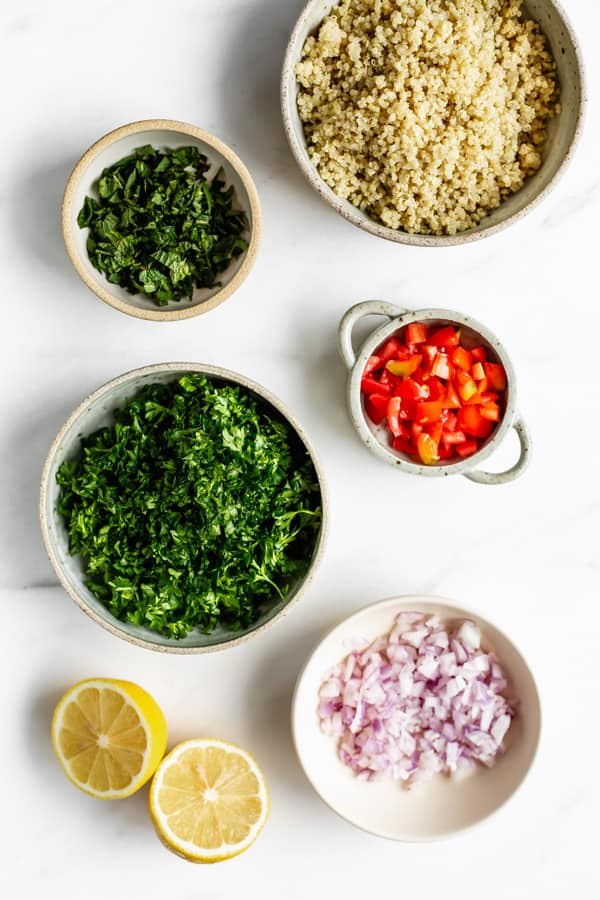 quinoa, herbs and vegetables cut up in bowls