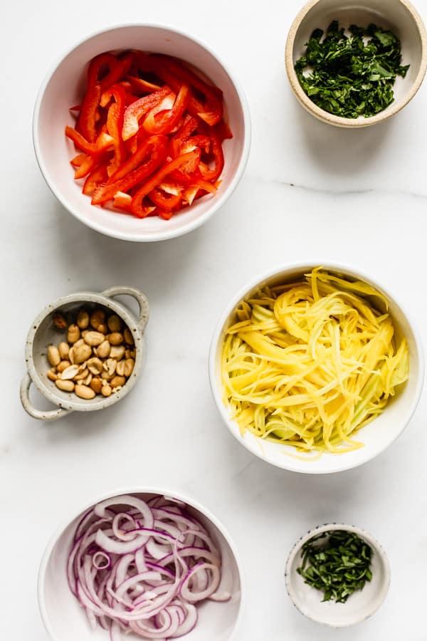 mango salad ingredients in individual bowls