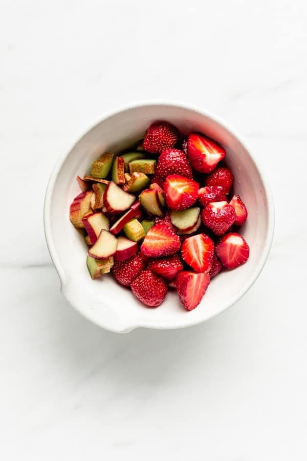 a bowl of strawberries and rhubarb chopped up