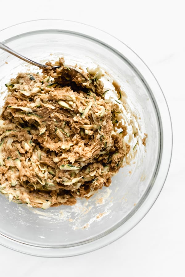 zucchini bread batter in a clear mixing bowl