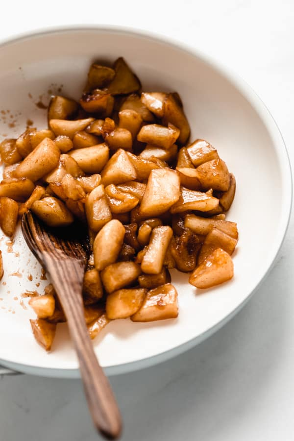 a pan with cooked cinnamon apples in it