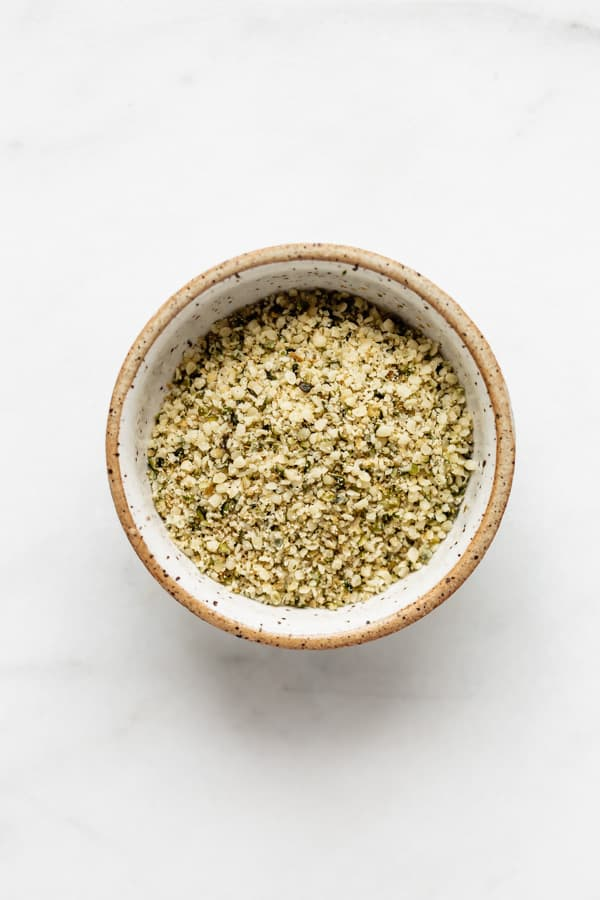 a small ceramic bowl with hemp seed parmesan in it