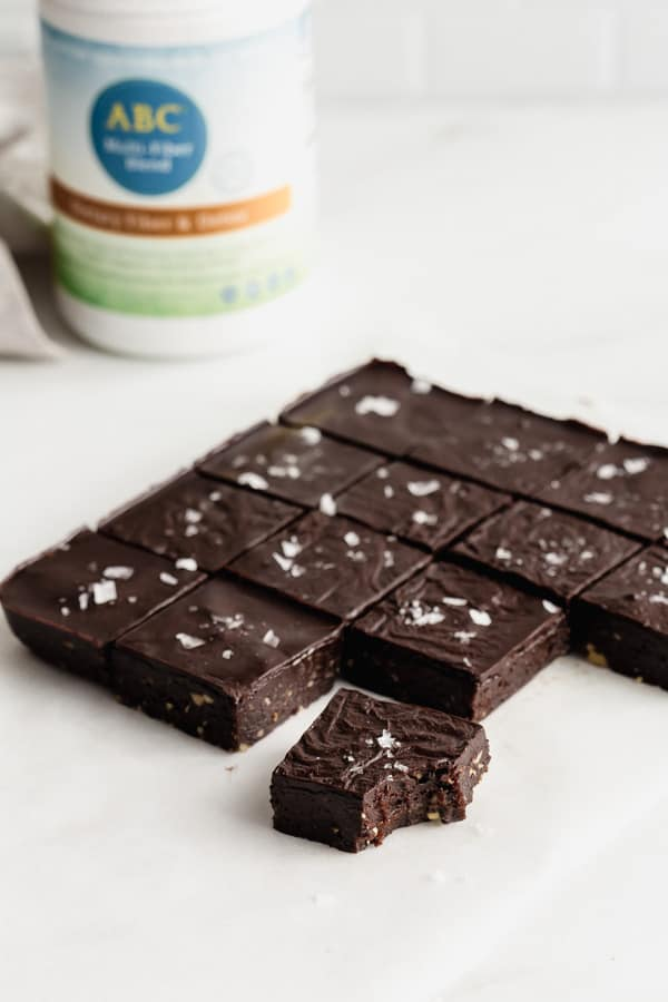 Brownies sliced on a marble board topped with sea salt