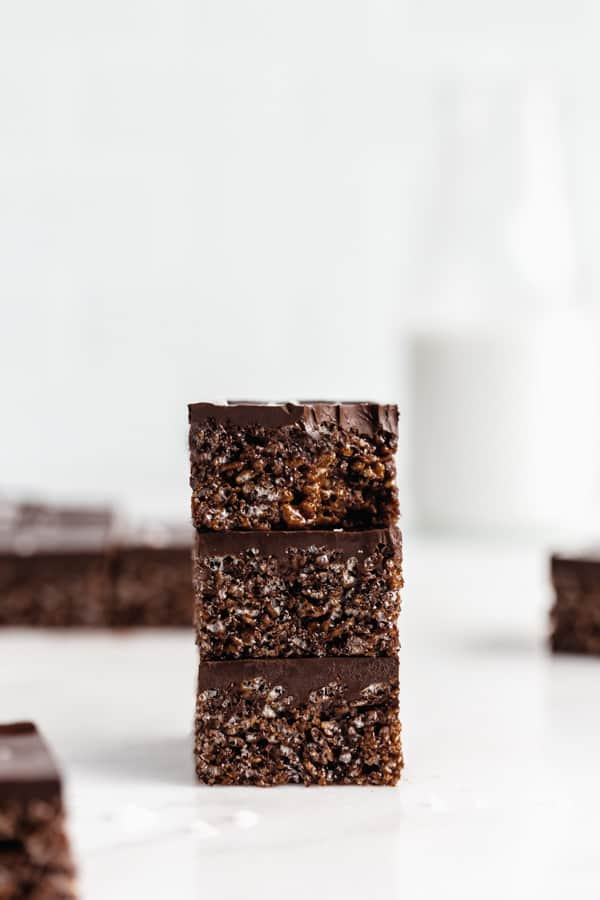 three chocolate rice Krispie treats stacked on top of each other