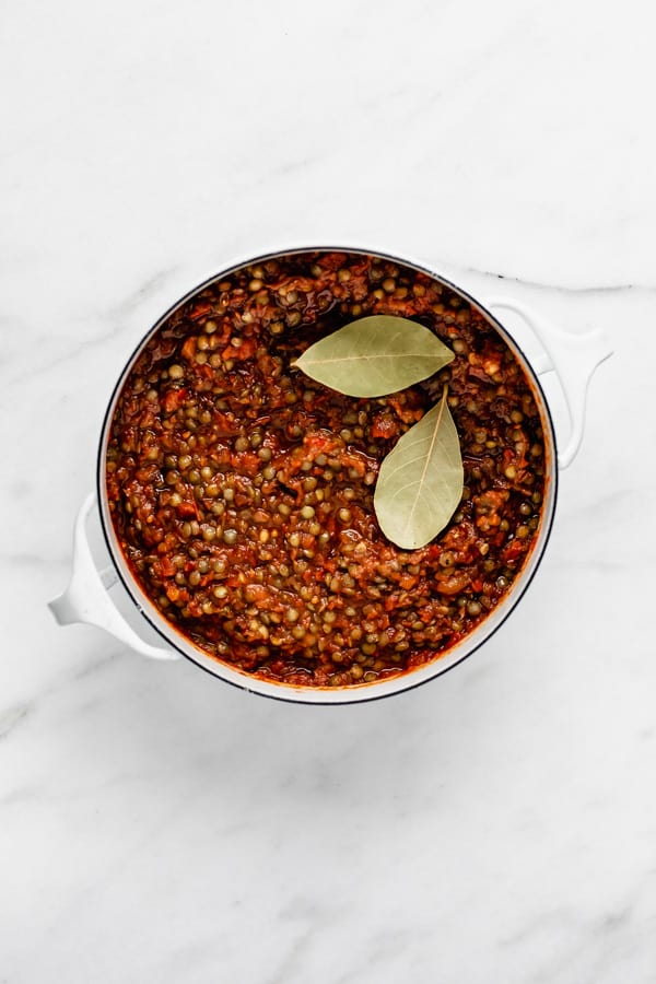 lentil bolognese sauce in a white pot