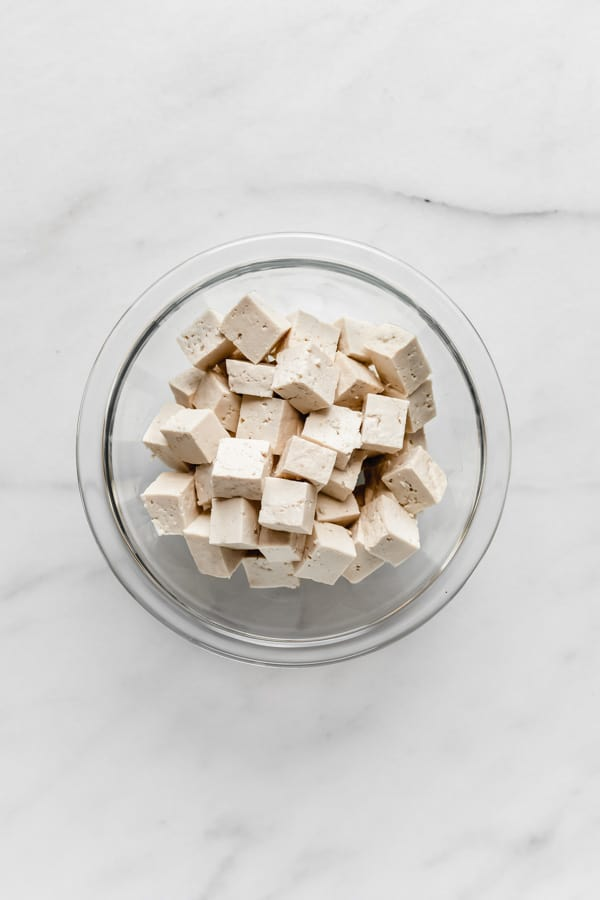 cubes of tofu in a clear mixing bowl