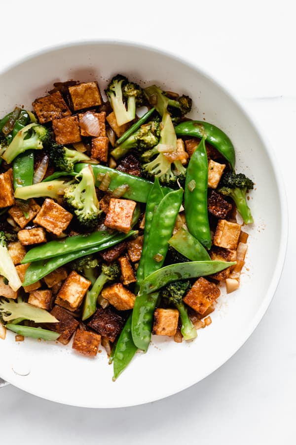 a pan filled with stir fry tofu and veggies
